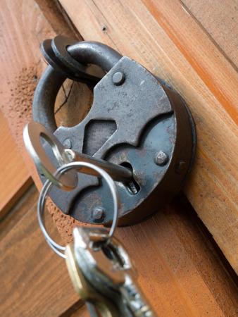 protection concept: Old padlock on a wooden door Stock Photo