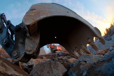land vehicle: Scoop of the excavator close up. Part of land vehicle. Stock Photo