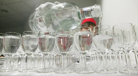 offender: The bartender pours vodka into a glass