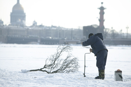 neva: Winter fishing on the Neva River in St. Petersburg. Russia.