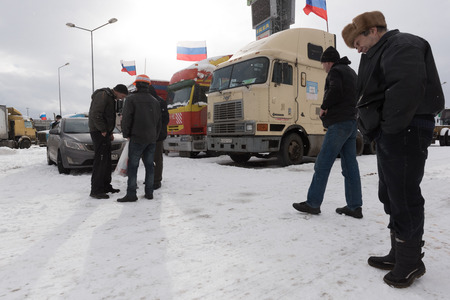 platon: Saint Petersburg, Russia. 23 February 2016:  Truck drivers and their supporters gather to protest against the new road payment system, named Platon. Truckers camp in the parking lot at the shopping center MEGA Dybenko in St. Petersburg