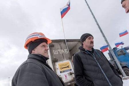 platon: Saint Petersburg, Russia. 23 February 2016:  Live NewsTruck drivers and their supporters gather to protest against the new road payment system, named Platon. Truckers camp in the parking lot at the shopping center MEGA Dybenko in St. Petersburg Editorial