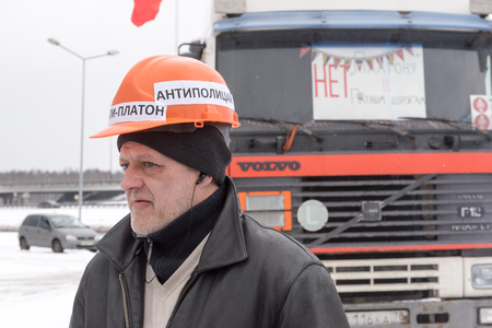 platon: Saint Petersburg, Russia. 23 February 2016:  Truck drivers and their supporters gather to protest against the new road payment system, named Platon. Truckers camp in the parking lot at the shopping center MEGA Dybenko in St. Petersburg.The word on the Editorial