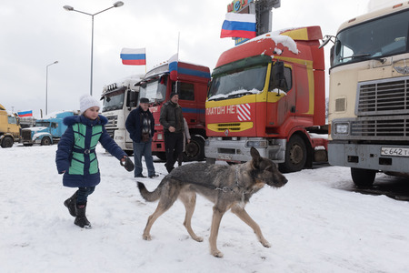 platon: Saint Petersburg, Russia. 23 February 2016: Live NewsTruck drivers and their supporters gather to protest against the new road payment system, named Platon. Truckers camp in the parking lot at the shopping center MEGA Dybenko in St. Petersburg %uFFFD