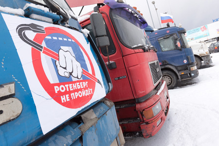 platon: Saint Petersburg, Russia. 23 February 2016:  Truck drivers and their supporters gather to protest against the new road payment system, named Platon. Truckers camp in the parking lot at the shopping center MEGA Dybenko in St. Petersburg.The poster read