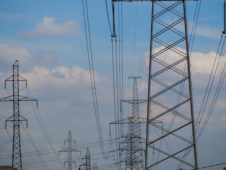 torres el�ctricas: a high voltage power pylons against blue sky