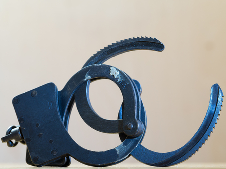 manacle: Photo of a pair of handcuffs