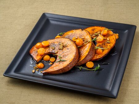 winter cherry: Baked pumpkin with winter cherry and rosemary. Stock Photo