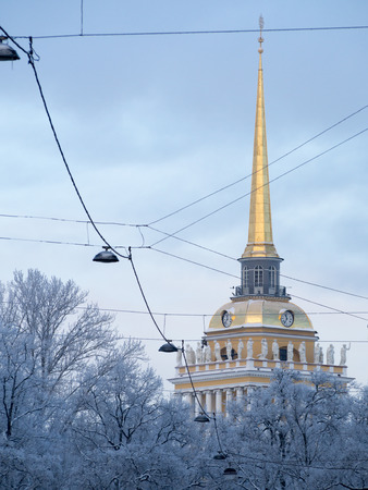 petersburg: Winter St. Petersburg. The spire of the Admiralty and the trees in the snow. Electrical wires and street lamps.