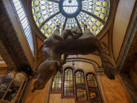 Prague, Czech Republic - January 8 2018.  The statue is of St. Wenceslas riding a dead upside-down horse. It hangs from the ceiling in the atrium of the Art Nouveau Lucerna Palace in Prague. Editorial