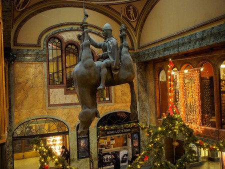 Prague, Czech Republic - January 8 2018.  The statue is of St. Wenceslas riding a dead upside-down horse. It hangs from the ceiling in the atrium of the Art Nouveau Lucerna Palace in Prague. Redakční