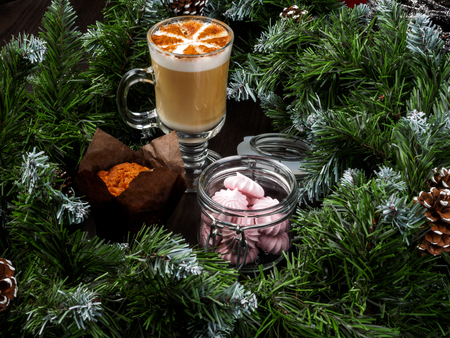 New Year's and Christmas cake and coffer on the table. Christmas festive cupcake. Archivio Fotografico