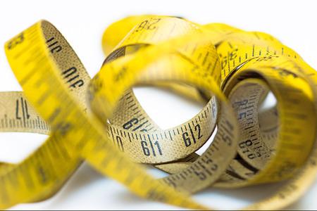 Vintage yellow measuring tape photo