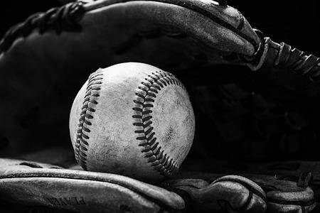 baseball catcher: Baseball glove with a ball