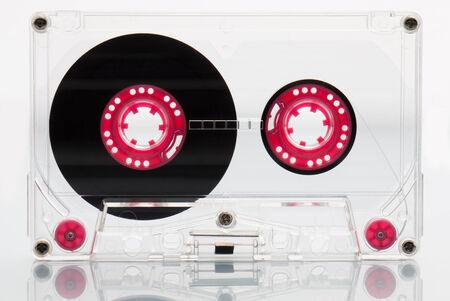 tape cassette: Audio cassette tape, pink.