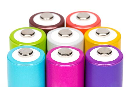 Multicolored AA size batteries isolated on white background. photo