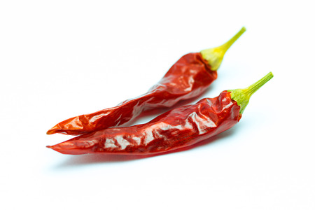 chili powder: Dried chili peppers on white background.