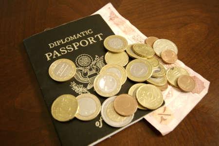 Money on Passport Stock Photo
