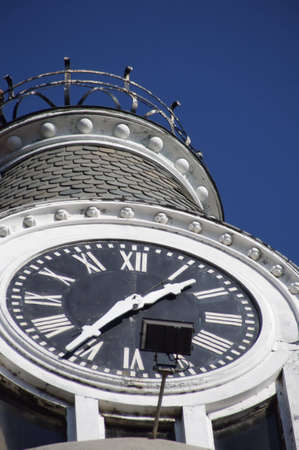 Large round clock on a tower