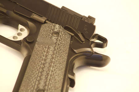 grip: 45 ACP pistol showing grip and trigger