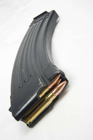 full metal jacket: Angled view of ak-47 magazine with full metal jacket bullets. Favored by insurgents and terrorists, this magazine shows signs of use and is loaded with bullets.