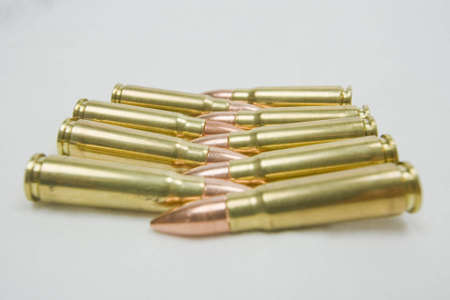 AK-47 assault rifle bullets in lines facing one another.