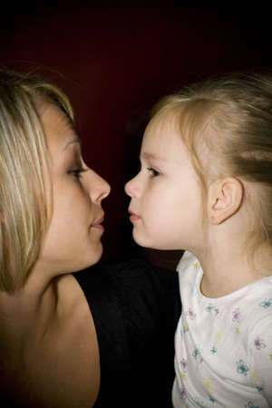 Mother and daughter getting ready to kiss