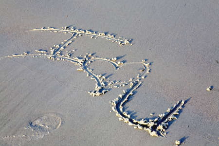 I love you message written in the sand with a heart symbol at the beach Фото со стока - 2812648