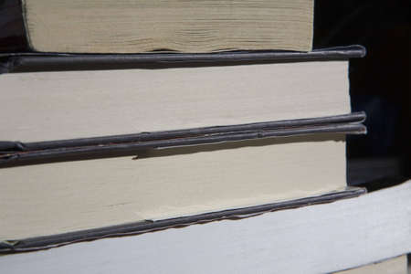 A stack of old books shot in a dim peaceful light.  版權商用圖片
