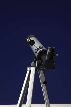 mystique: Telescope looking up into the night sky.  Stock Photo