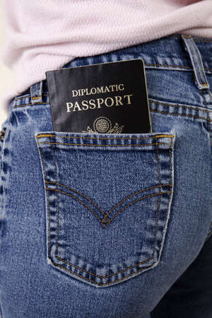 butt tight jeans: Woman with a diplomatic passport sticking out of her rear pocket. Immunity carried close.