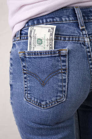 Sexy woman with a five dollar bill in her rear pocket