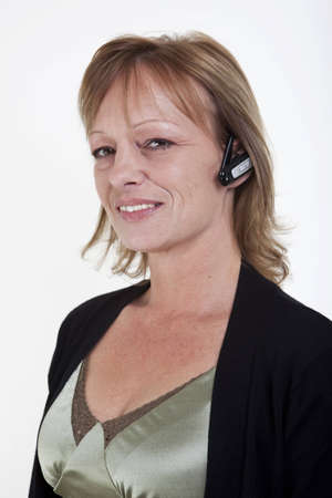earpiece: A woman with a wireless earpiece for mobile communication Stock Photo