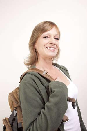 Female hiker with backpack over her shoulder ready for spring hiking