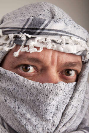 A man in tribal headress of the middle-east or central asia