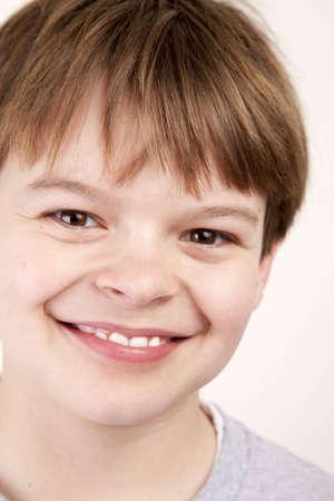 Closeup portrait of a happy young boy