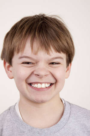 snarl: A young boy with a playful snarl expression Stock Photo