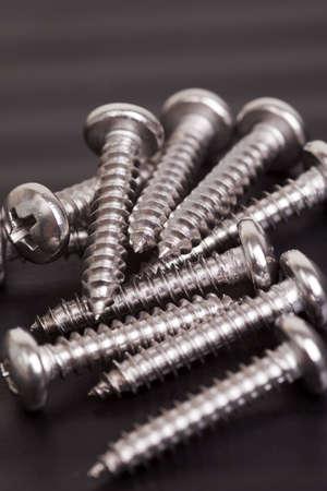 Pile of silver colored construction screws 版權商用圖片