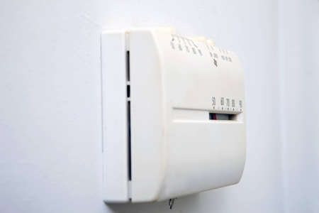 Control unit for a central heat and air system showing a low indoor temperature