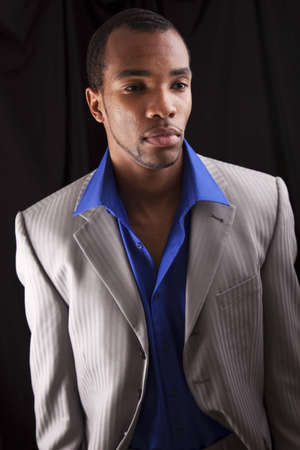 African american male dressed fashionably on a black background.