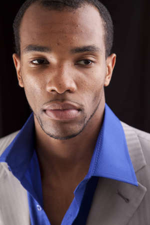 Headshot of a man of african descent dressed in business casual fashion