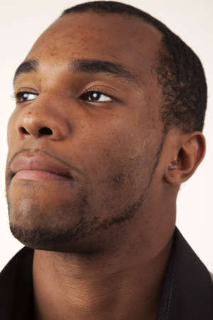 An african american man looking into the distance. Closeup headshot.  Stock Photo