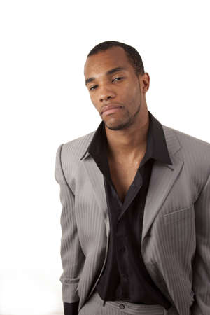 An african american man with a questioning look on his face dressed fashionably Stock Photo - 4510615