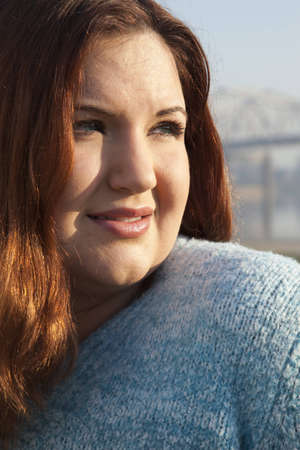 Plus sized woman posed looking away from camera. Stock Photo