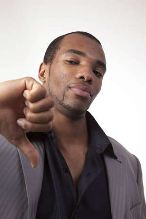 African american man in dress clothes giving a thumbs down sign