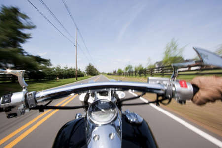 Shot from rider perspective of a motorcycle cruising down a small country lane.  Stock Photo