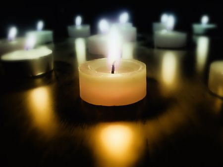 spirituality: Burning candles in the dark Stock Photo