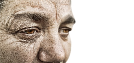 mature old generation: striking dramatic look of a old woman Stock Photo