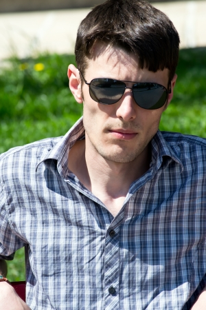 Attractive young male with sunglasses  photo