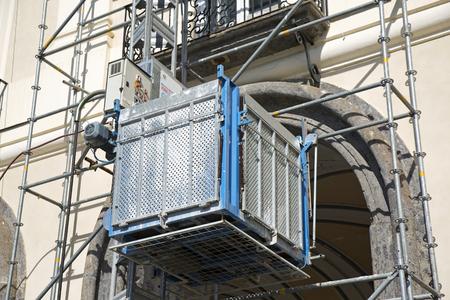 building external: External elevator on the facade of an historical  building Stock Photo